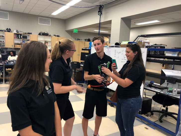 6 MSSE students, Tia Lilliman, Devin Ramsey, Alex Burgans, and Suzy Houser discuss vertical climbing robot at CISCOR.png