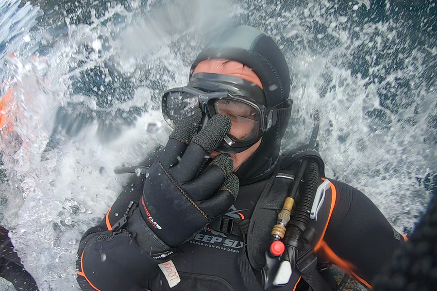 diver jumping in water