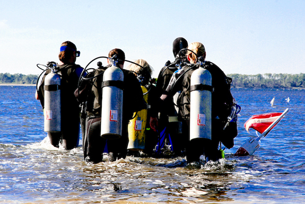 Scuba divers preparing to dive St. Andrews State Park
