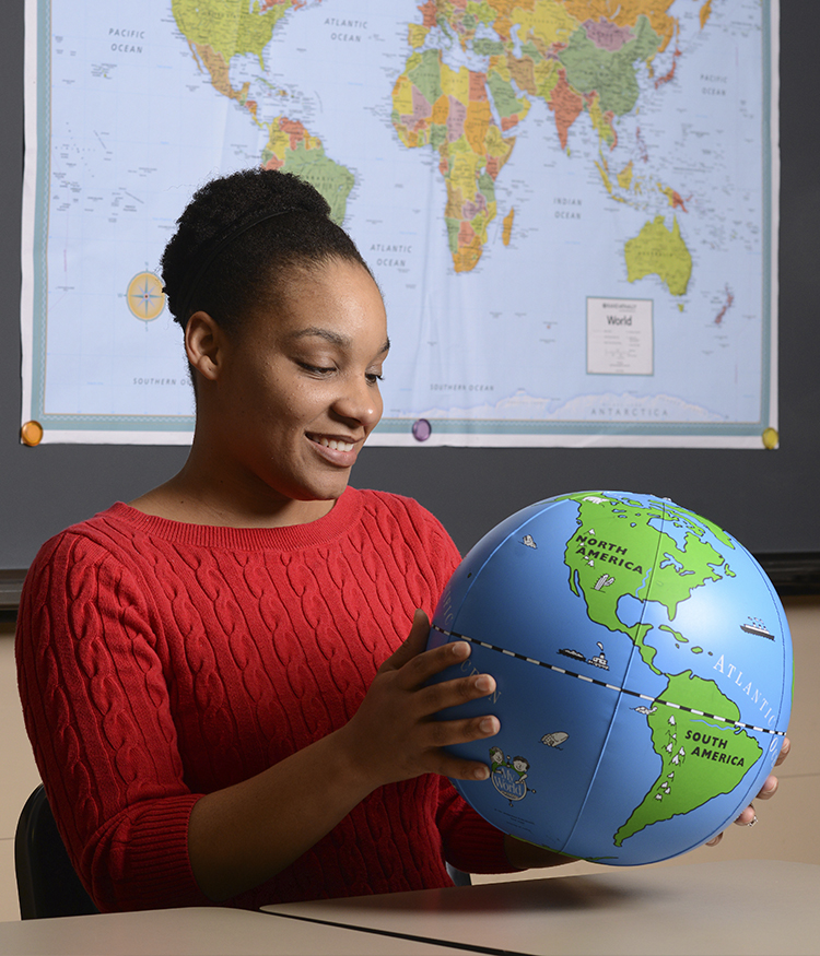 Social Science, Interdisciplinary student holds world globe