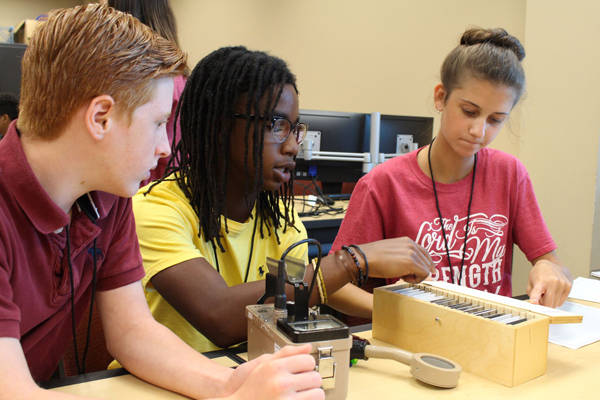 Students use PASCO absorber set to evaluate materials