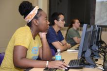 Mixed-gender students at computer