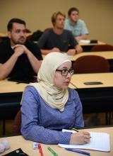 Female Muslim student at desk
