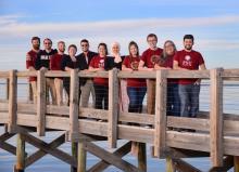 FSU Panama City students pose on campus dock