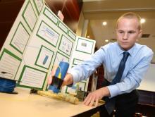 Male student exhibiting ECE Senior Design Project