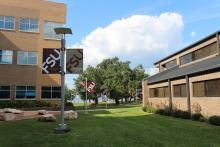 Greenway between the Holley Academic Center and Office buildings with FSU flags