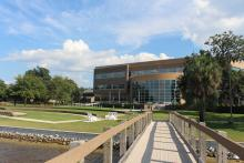 Backyard of the Holley Academic Center from the pier