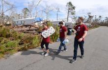 Students carry supplies to homes effected by Hurricane Michael