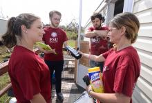 Students talk with Hurricane Michael survivors
