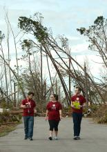 Students looking at Hurricane Michael damage