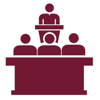 Graphic of an instructor at a podium in front of people